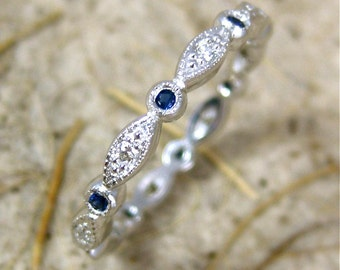 Elegant Diamond & Blue Sapphire Wedding Ring in 14K White Gold with Shield and Round Bezels Eternity Size 4