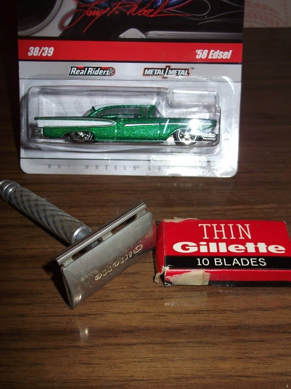 gold safety razor with a box of razors