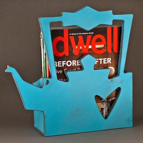 magazine rack\/ turquoise kettle.