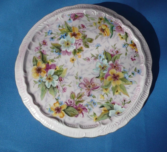 Yellow and White Flowers on a Trivet Hot Plate