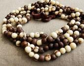 white and gray acai beads