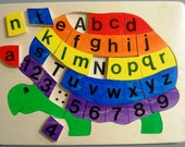 ABC Turtle  wood puzzle in rainbow colors makes a fun and educational wooden toy for children. This classic toy will be kept for generations