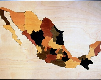 Wooden map of Mexico puzzle with states printed on tray and and capitals on backs of pieces - an educational toy for kids and adults alike