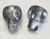 18 pcs Dark Grey Glass Skull Beads Insurance Included with All Orders