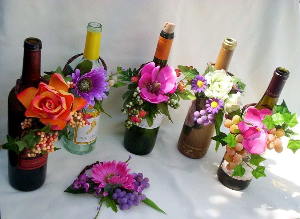 Tropical wedding reception wine bottle centerpieces by Wine bottle wedding centerpieces