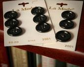Nine black La Mode buttons