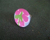 Adorable Colorful pink flower ring featuring preppy fabric.