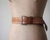 vintage 1960's tooled leather belt