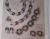 Vogue 1957 Ad Alice Safari Jewelry
