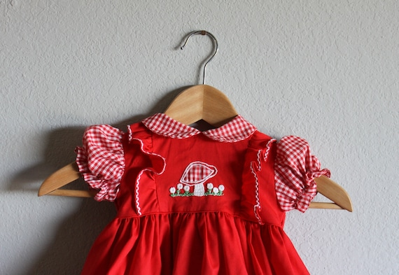 VINTAGE red childrens DRESS with embroidered mushroom