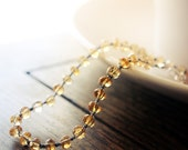 ARIADNE gemstone bracelet - macrame knotted cord - faceted citrine gemstones - sparkling honey gold tones.