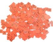 Anagrams orange cardboard letters with vintage Christmas box Greetings