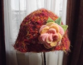 Handmade pink and orange crochete hat with peach pink rose
