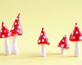 Set of five red and white pointed toadstools for terrariums, plants or cake toppers