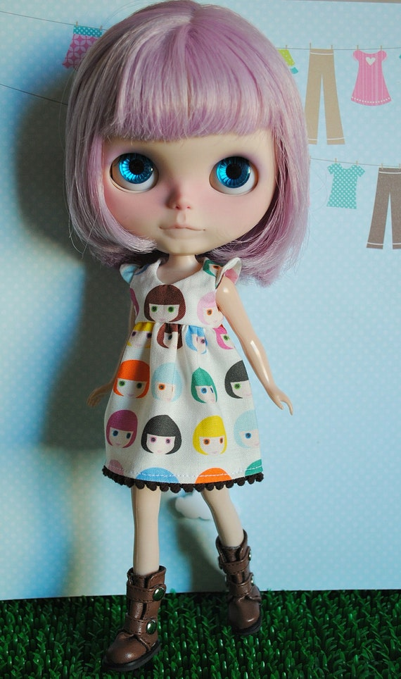 Blythe dress with ruffle sleeves.