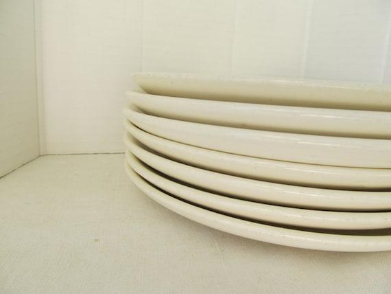 RESERVED- Set of Seven Vintage Plates