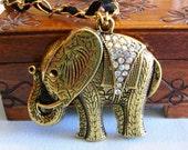 Bollywood Elephant Necklace, large elephant pendant, rhinestone, ribbon entwined necklace, black and gold