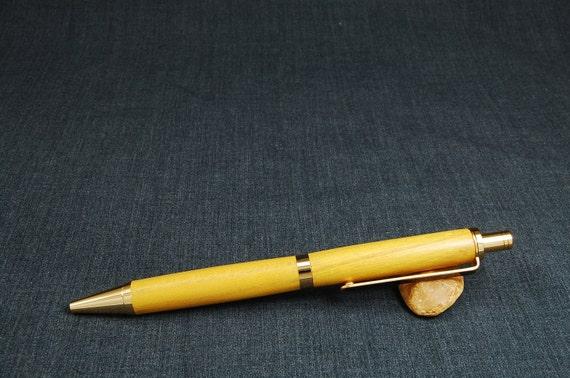 Osage Orange Slimline Pro click pen with 24k Gold parts
