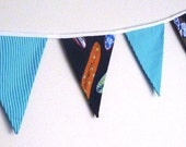 Boys bunting flags with surfboards