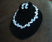 Silver and Glass- Faceted sky blue glass and laser cut silver comprise this delicate choker.