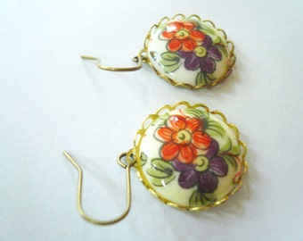 Romantic victorian earrings. Red and purple garden flowers set in lacey brass on 14K gold fill ear wires.