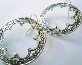 Silver hoops. Earrings with large antiqued silver filigree on sterling silver ear wires.