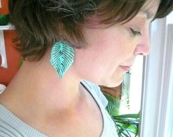 Large blue feather earrings. Blue leaf earrings. Big leaf earrings. Big blue dangles. Big blue dangle earrings. Big blue feather earrings.