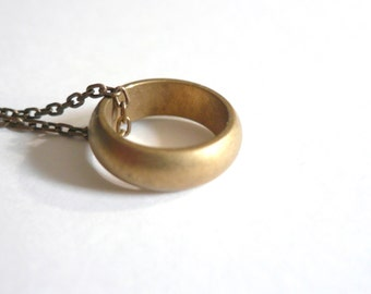 Gold ring necklace. Vintage brass wedding ring or promise ring with gorgeous patina on long brass chain.