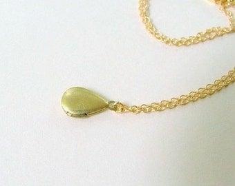 Gold locket necklace. Tiny vintage brass teardrop on delicate 14K gold fill (GF) chain