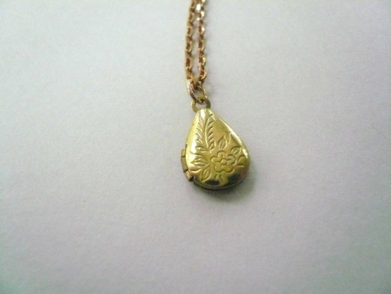 Pretty gold locket necklace with embossed vintage brass teardrop on new brass necklace chain.