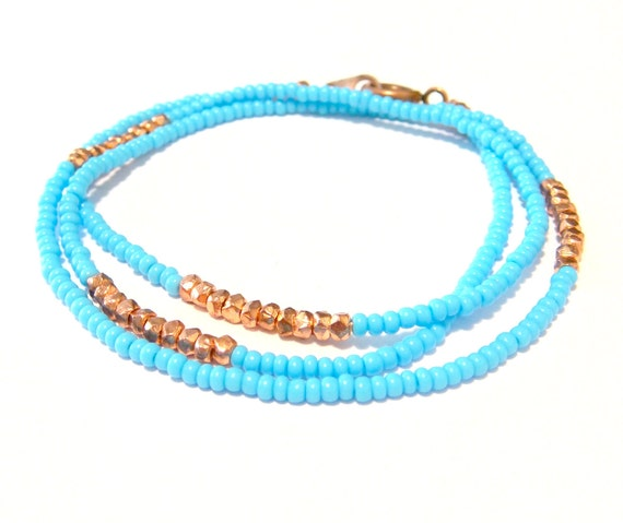 lakehouse // bracelet / necklace with mini geometric nugget copper beads on background of light blue seed beads