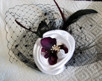 Headpiece fascinator with veiling white deep purple center