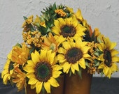 sunflowers in pottery vase