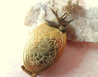 In Flight. Double Locket with Swallow Bird Charm Necklace.
