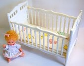 Vintage 1970's Barbie size white doll crib comes with the cutest ever tiny baby doll