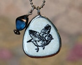 Black and White Flying Bird Pendant Necklace with Blue Bead