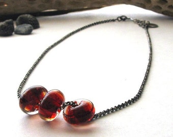 Blood red glass bead necklace. Sterling silver with boro lampwork. Oxidized sterling silver chain. Deep transparent wine. Captain Cherry.