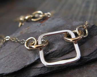 Mixed metals geometric necklace. Modern minimalist jewelry. 14K gold filled and sterling silver.  Square with circles.