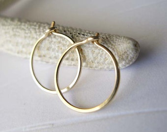 Solid 14k gold tiny thin hoop earrings. Minimalist jewelry. Sleeper hoops comfortable for sleeping in. Artisan handmade gift for women