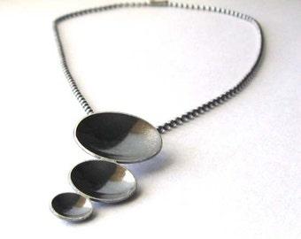 Modern oxidized sterling silver artisan pendant & ball chain necklace. Urban dome disc trio.  Dramatic contrast. Shadows. Prenumbra.
