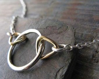 Simple modern sterling silver and gold filled geometric necklace.  Triangles and ring jewelry.