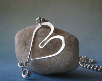 Stylized heart sterling silver pendant necklace.  Scuplted wire work artisan jewelry.  Simple & lightweight.  Made with love.  Ball chain.