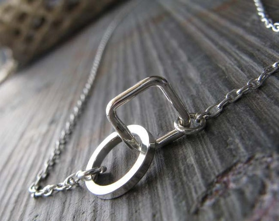 Simple minimalist sterling silver geometric necklace.  Square and circle ring modern jewelry.