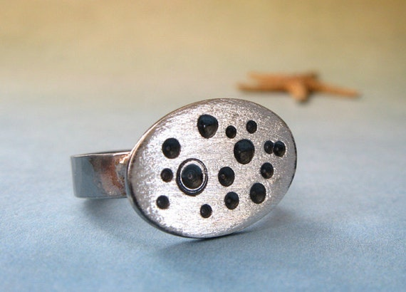 Rustic sterling silver oval ring with thick textured 4mm band.  Organic dot pattern.  Brushed and oxidized finish.  Craters.  Barnacle.