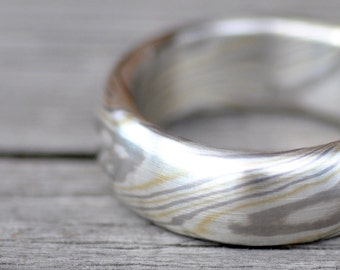 three-colored mokume gane band. wedding ring. engagement ring. silver, gold and palladium. custom-made.