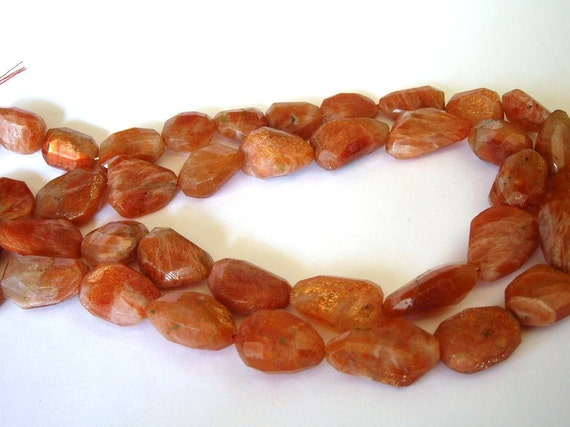 Sunstone faceted nuggets 7 inch strand