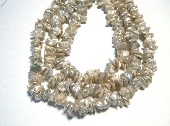 Keishi petal flat pearls ivory white 7in strand
