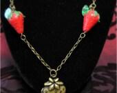 Beaded strawberry locket