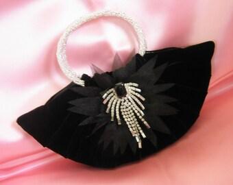BLACK SILK VELVET EVENING BAG W\/ SILVER HANDMADE BEADED HANDLES, DECORATED w\/ a VINTAGE DECO RHINESTONE BROOCH