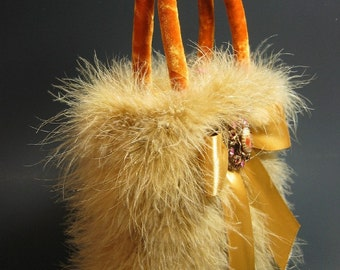 AMBER GOLD VELVET EVENING BAG DECORATED with GOLDEN MARABOU FEATHERS, SATIN BOW and VINTAGE BROOCH